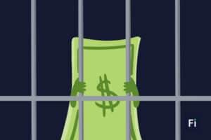 Un billete preso en una cárcel, simulando la esclavitud de salir de deudas